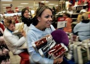 Insane Santa shoppers. Photo courtesy of : sodahead.com