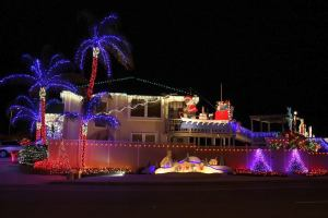 This home has a very tan Santa piloting a boat on top, Peanuts on bottom, and a nativity canal-side.